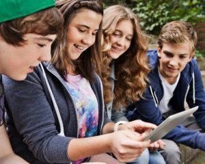 16 Jul 2012 --- teens using tablet pc --- Image by © Daniel Koebe/Corbis
