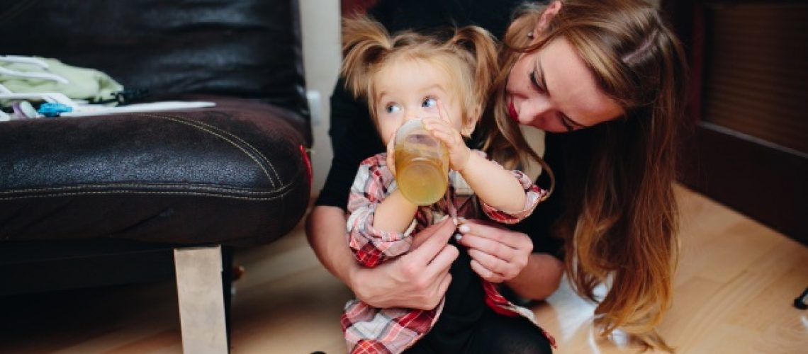 distracted-girl-drinking-a-juice-with-her-mother_1153-1821
